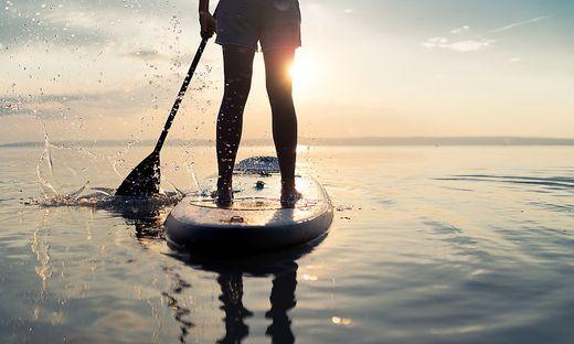 summer sunset lake paddleboarding detail