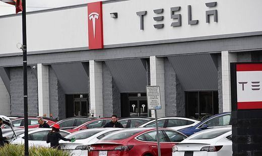Tesla profit doubles as car deliveries surge