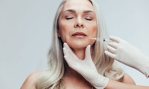 Female getting anti aging shots on her face