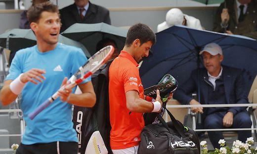 Dominic Thiem (links) und Novak Djokovic mussten ihr Duell am Freitag vorzeitig beenden