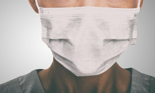 Doctor wearing protection face mask against coronavirus. Banner panorama medical staff preventive gear.