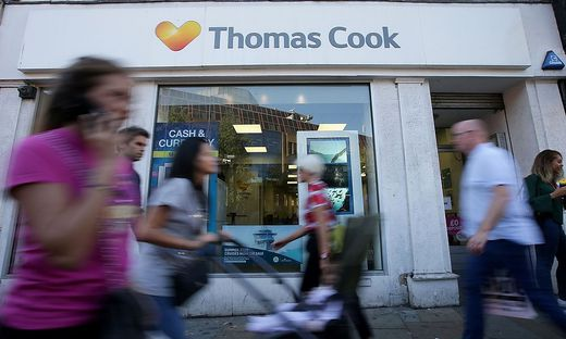 FILES-BRITAIN-BUSINESS-TRAVEL-EARNINGS-THOMAS COOK