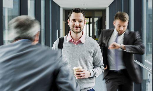 Calm businessman in contrast to businessmen in a hustle