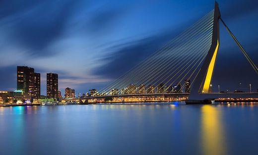 Skyline Rotterdam by night with the Erasmusbrug