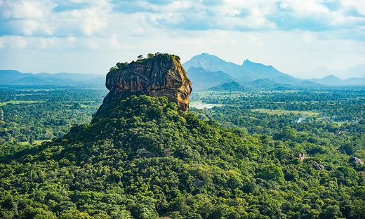Spectacular view of the Lion rock surrounded by green rich vegetation. Picture taken from Pidurangala Rock in Sigiriya, Sri Lanka.