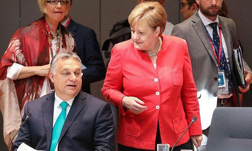 Orban und Merkel