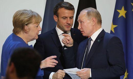 TOPSHOT-FRANCE-RUSSIA-GERMANY-UKRAINE-POLITICS-CONFLICT-DIPLOMAC