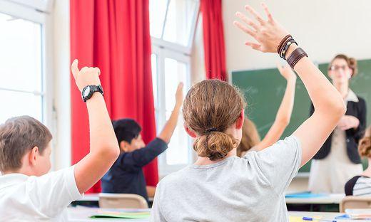 Teacher  educate or teaching a class of  pupils in school