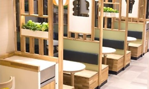 Viel Holz, viel Grün: Das neue Design von McDonald's