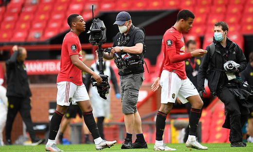 Manchester United, ManU v AFC Bournemouth - Premier League - Old Trafford TV camera operator wearing a face mask follow