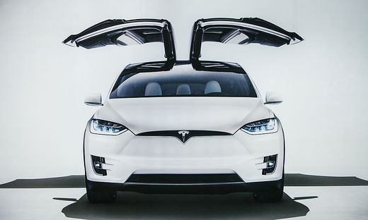 Berlin, October 2, 2017: Photo of the image of an electric vehicle Tesla model X at the Tesla motor show in Berlin. A modern electric car.