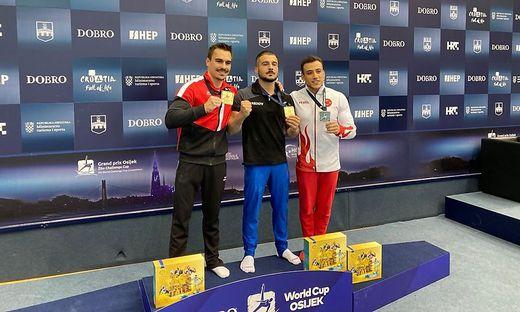 Die Sieger Vinzenz Höck und Salvatore Maresca mit dem Dritten Adem Asil