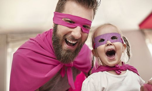Father and daughter playing superhero and superwoman model released Symbolfoto property released PUB
