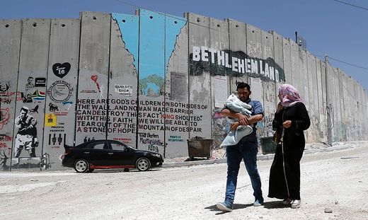 TOPSHOT-PALESTINIAN-ISRAEL-CONFLICT-WALL