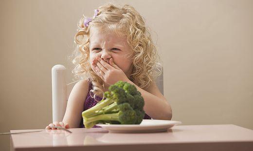 USA, Utah, Lehi, girl (2-3) disgusted with broccoli