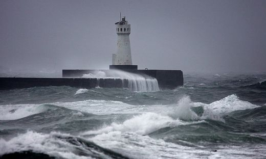 WAVES HIT LIGHTHOUSE