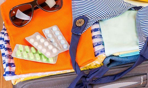 Tabletten; Koffer; Packen