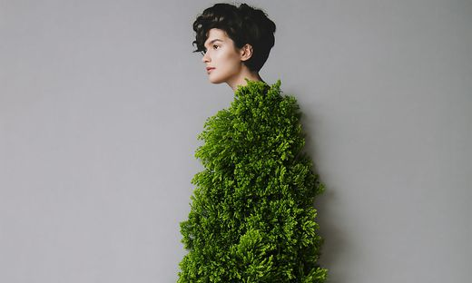 Collage with female portrait and green plant