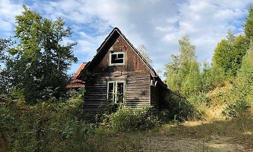 In einem Teil dieser Hütte lebte der Mann