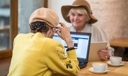 Senior women in cafe.