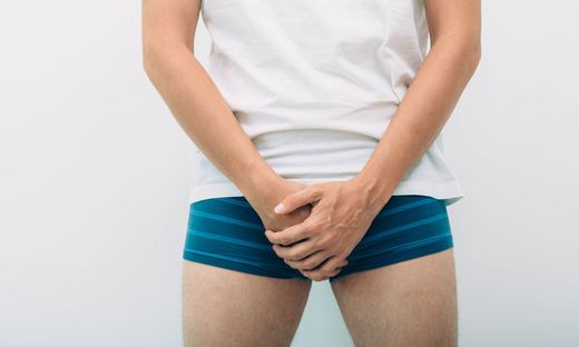 man wearing underpants holding genitals prostate problem. Men´s health, venereologist, sexual disease