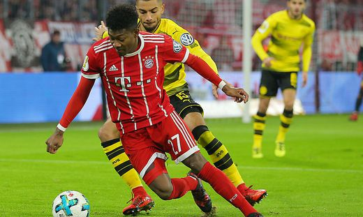David Alaba (in rot) ist mit den Bayern in Dortmund gefordert