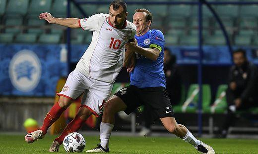 (201012) -- TALLINN, Oct. 12, 2020 -- Goran Pandev (L) of North Macedonia vies with Konstantin Vassiljev of Estonia dur