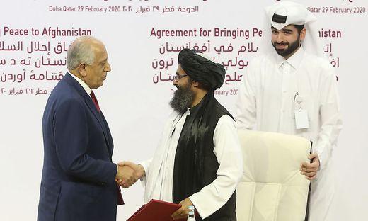 U.S. peace envoy Zalmay Khalilzad, left, and Mullah Abdul Ghani Baradar