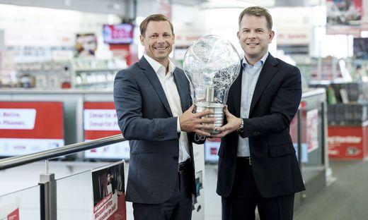 Marc Oliver Klemm (MediaMarkt/Saturn) und Christian Ammer, Geschäftsführer von Switch