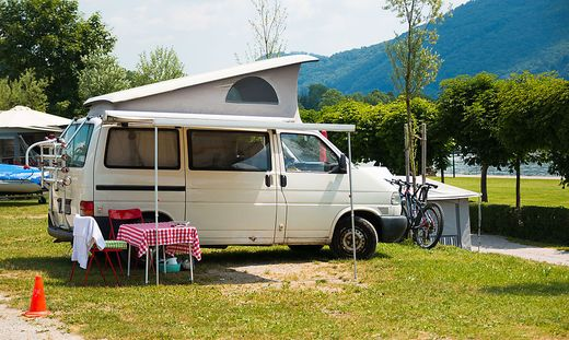 Trailers camping on Traunsee lake shore in Austrian Alps