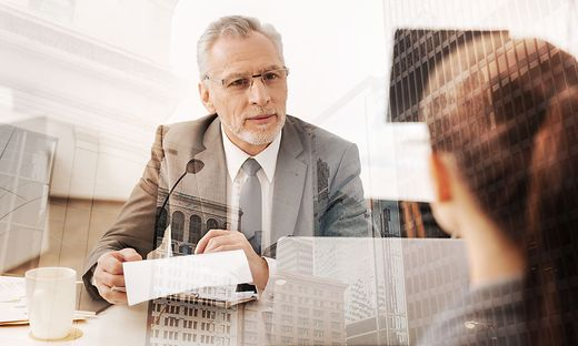 Positive adult HR manager conducting a job interview