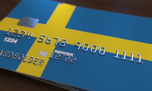 Plastic bank card featuring flag of Sweden. National banking system related 3D rendering