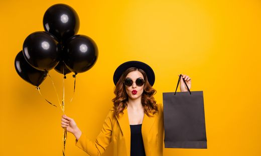Close up photo beautiful she her lady vacation abroad send air kiss carry packs perfect look buy buyer present gift balloons sale discount wear specs formal-wear suit isolated yellow bright background