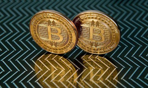 Bitcoin gibt es eigentlich nur digital. Symbolbild