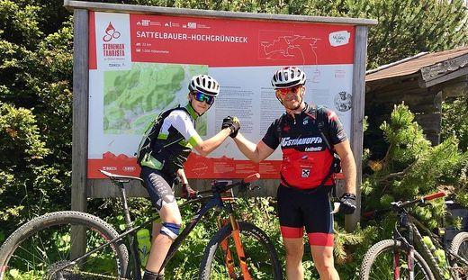 Lukas Hernach (13) mit seinem Papa Christian Hernach auf der Strecke der Stoneman-Gold-Trophy