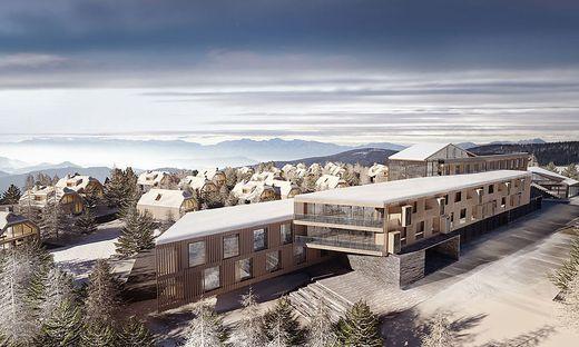 Das Alm Vital Resort mit seinen einzelnen Hütten aus Holz und Glas sowie dem zentralen Baukörper mit Hotel
