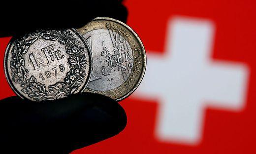 Euro und Franken Muenzen