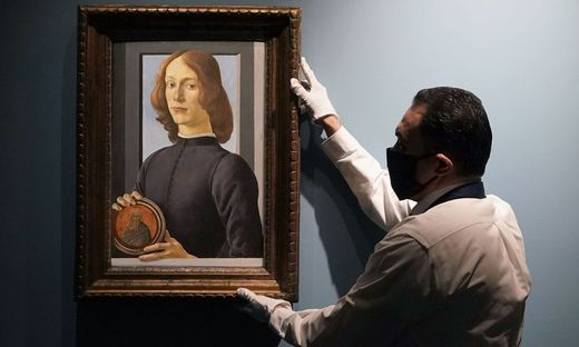 Auction at Sotheby's of Botticelli's 'Portrait of a Young Man Holding a Roundel'
