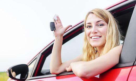 Woman showing keys.