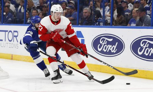 TAMPA FL OCTOBER 18 Detroit Red Wings center Michael Rasmussen 27 is defended by Tampa Bay Lig