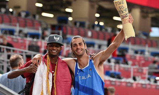 Mutaz Essa Barshim aus Qatar und der Italiener Gianmarco Tamberi teilen sich eine Goldmedaille
