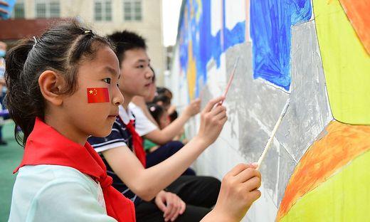 China erlaubt Drei-Kind-Familie