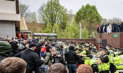 May 2, 2021, Manchester, United Kingdom: Police officers move in to disperse football fans during a protest against the