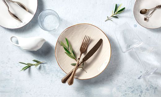 Modern tableware, overhead flat lay shot with olive branches