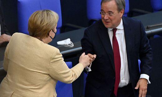 Angela Merkel und ihr bislang eher glückloser Nachfolger