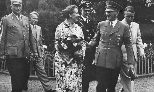 'Adolf Hitler (right), German Nazi politician, with Winifred Wagner in the vill