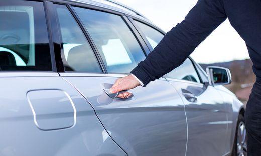 Hands On Car Door