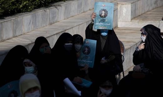 Iran: Elections Campaign in Tehran Supporters of presidential elections candidate Ebrahim Raisi hold electoral posters f