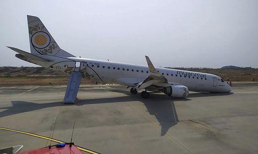 Bauchlandung in Myanmar: Flugzeug landet ohne Vorderreifen - keine Verletzten