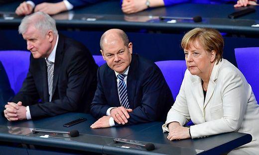 Seehofer, Scholz und Merkel